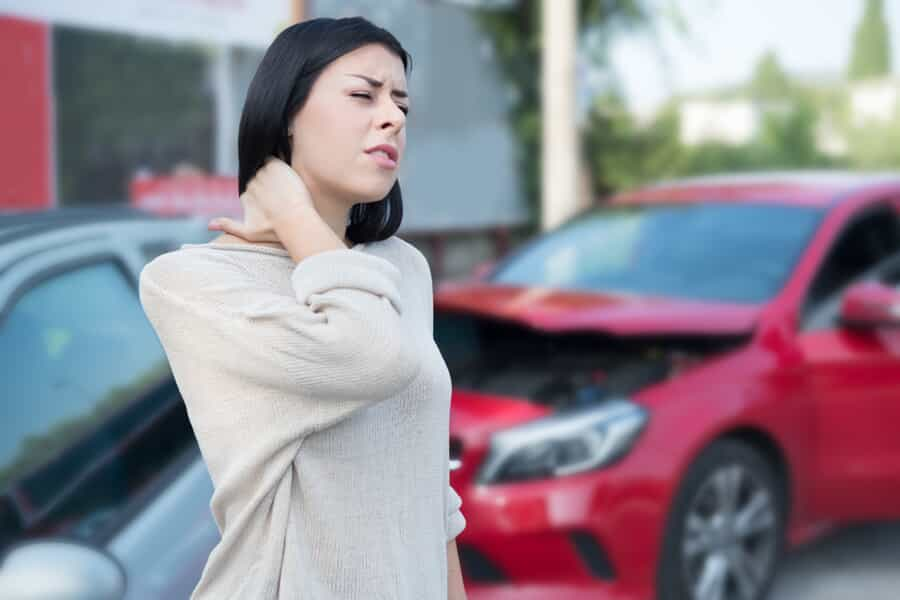 Woman Holding Neck After a Car Accident